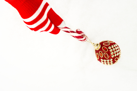 Christmas card, gloves on hands holding hook candy and grab ball isolated on a white background with space for text
