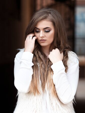 portrait of a beautiful girl with beautiful hair and makeup