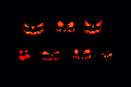 The concept of Halloween. A lot of Evil scary pumpkin in the dark. Jack Lantern in the darkness