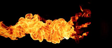 hellish: Halloween concept. The evil terrible pumpkin spews the hellish flames. Jack Lantern in dark Stock Photo