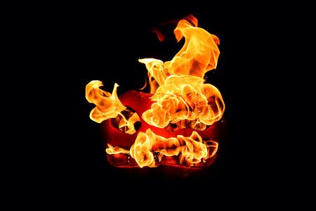 hellish: The concept of Halloween. The evil terrible pumpkin spews the hellish flames. Jack Lantern Stock Photo