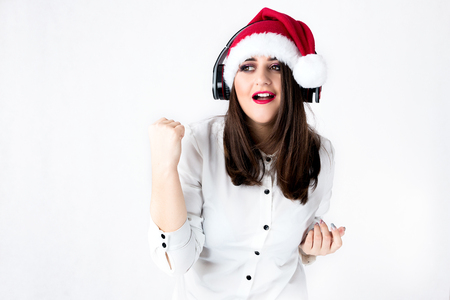 Spirit of Christmas thick girl in Santa Claus cap model XXL, woman plus size in lingerie fat Santa listen music with headphones