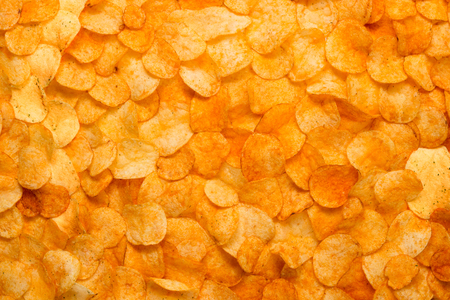 Chips texture crisp potato background of golden unhealthy food pattern web design banner poster flat lay. Big many potato chips