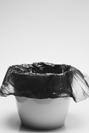 Ecology recycle concept, garbage bin with trash paket on white background with copyspace for text