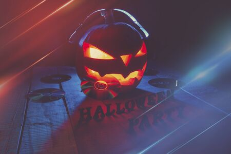 The concept of Halloween. Pumpkin jack Lamp, in headphones with CDs in the teeth and the inscription Halloween party with warm and cold light, poster for the party