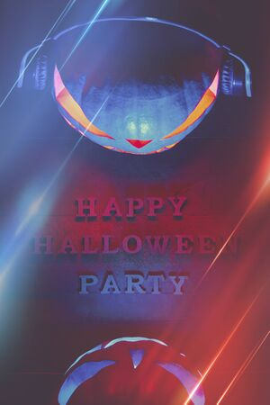 Halloween concept. Two pumpkins in headphones, with a warm and cold glow, a poster for a party with an inscription