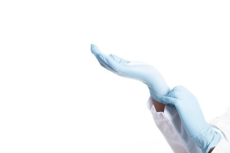 Close up hands doctor in medical coat. Doctor wearing latex gloves Imagens
