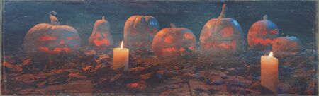 The concept of Halloween. A lot of luminous evil terrible pumpkins, jack-lantern, with candles, leaves with a warm and cold blue light on the wooden floor in the smoke. Ultra wide photo Imagens