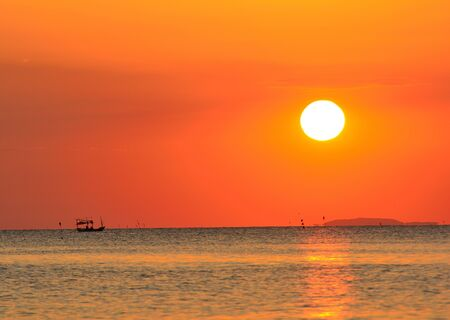 Fishing boat in the sea Having a sunset is the background