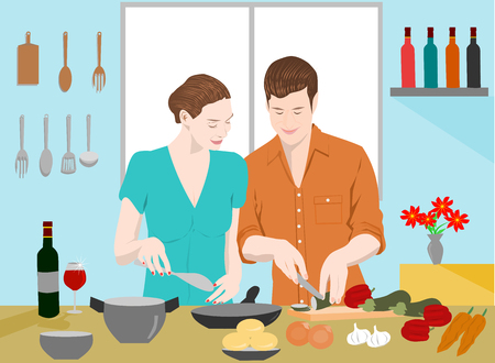 Couples are cooking together in the kitchen. There are bottles of wine and cookware on the blue wall. There is light shining through the windows