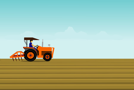 The man is driving a orange tractor. In order to plow the soil in the field. Have a blue sky background