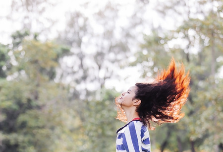 Beauty Girl Outdoors shake hair in the air photo