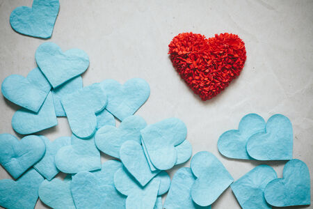 Paper made for red heart with blue hearts in white paper background, vintage tone. photo