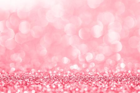 抽象的な背景のピンクのキラキラ
