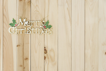 Christmas border on wooden board background.