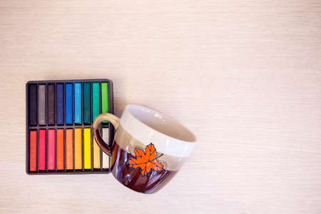colrful: Christmas cup with color in box on wooden table with copy space. Stock Photo