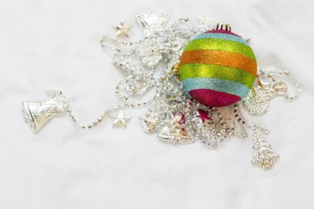ball and chain: Rainbow Christmas ball with christmas chain on a white background.