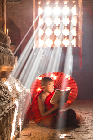 BAGAN, MYANMAR - FEB 20: Unidentified young Buddhism novices pray at temple on February 20, 2015 in Bagan. Buddhism is predominantly of the Theravada tradition, practised by 89% of the population.