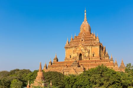 fascinate: Ancient pagoda with blue sky in Bagan, Myanmar. Stock Photo