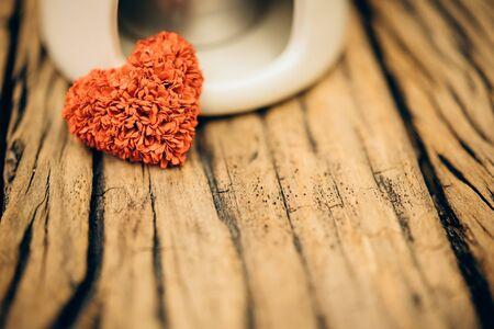 admire: Retro valentine heart on old wood background. Stock Photo