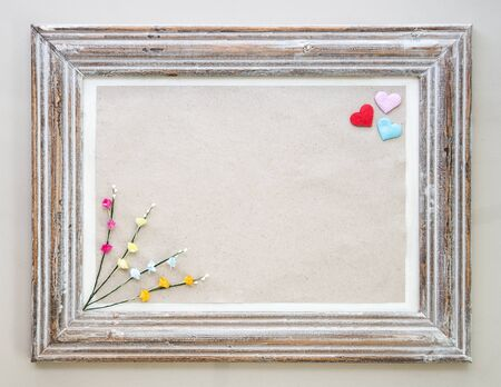 hearts day: Vintage wooden frame with hearts and flower for Valentines day background. Stock Photo
