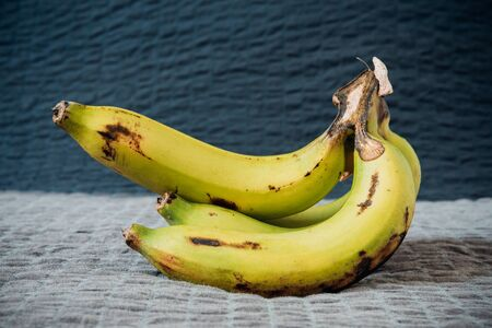 Stil: Banana still life on a sackcloth with natural light. Stock Photo