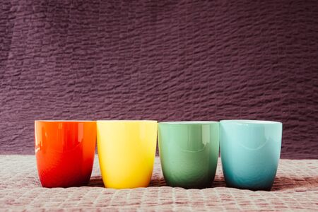 Colorful coffee cups on grunge background