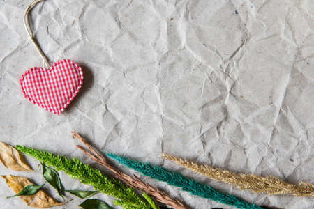withered flower: Beige crumpled paper with heart and withered flower for valentine background.