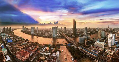 plano: Bangkok Transportation at Dusk with Modern Business Building along the Chaopraya river (Thailand) Stock Photo
