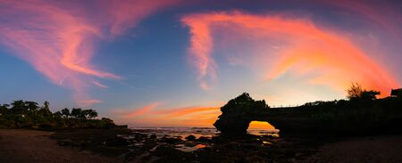 sunrise ocean: Panoramic of beautiful sky sunset at hindu temple Pura Tanah Lot, Bali, Indonesia.