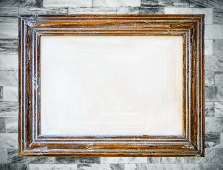 exposition: Vintage wooden frame on old marble wall background.