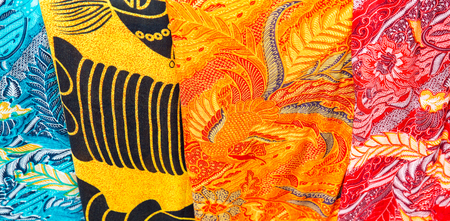 Colorful balinese cloth for sale, Abstract fabric texture background.