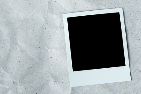 paperboard: White photo frame on white texture paper background. Stock Photo