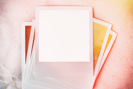 sun burnt: Photo frames on paper background with sun flare and warm light.