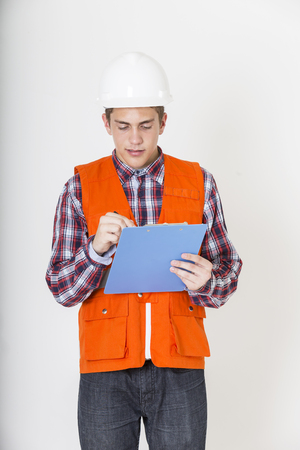 Engineer working with checklist. Stock fotó
