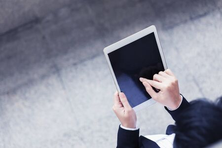 Closeup of business people working with tablet with free space.