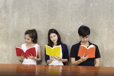 Group of students reading in school.