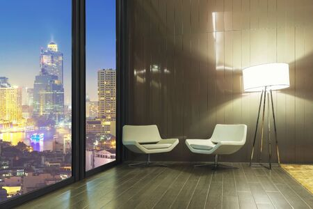 Interior of white sofa set with lamp in resting room with cityscape night view outside the window.
