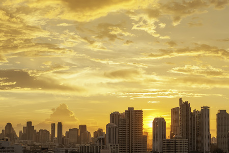 Modern high building in Bangkok city, Thailand. Cityscape at sunset in summer. Business city center with warm sky. Picture for add text message. Backdrop for design art work. Stock fotó