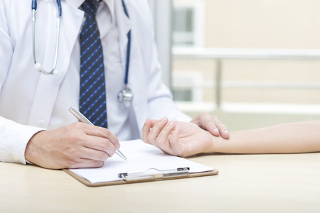 Healthcare concept. Doctor checking heart pulse for patient. Stock fotó