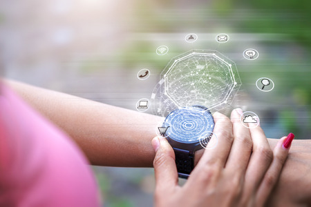 High technology digital hologram icons application  on hand watch screen while exercise lifestyle. Stock fotó