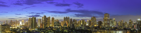 Panorama of modern high building of bangkok business city center at twilight. Picture for add text message. Backdrop for design art work. Stock fotó