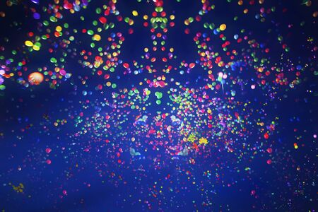 Colorful balloons flying into the blue sky at night. Holiday, festival and party background.