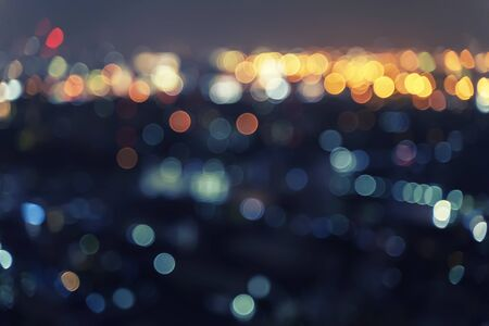 Abstract background from blurred bokeh light at night in the city.