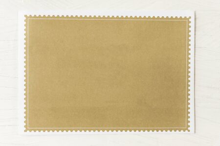 Empty brown paper on white table background.