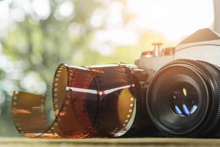Vintage camera with film roll on the ground. Travel background Stok Fotoğraf - 132124541