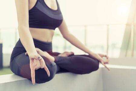 Healthy and relaxation concept. Closeup of sport woman doing yoga pose on mat in park. Lifestyle in holiday.