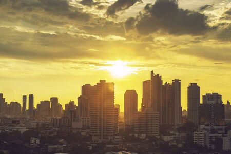 High modern building in business city center of Bangkok at sunset. Travel to Thailand.