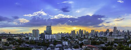 City scape of Bangkok city at sunset with beautiful sky and cloud. Business district center. Asia travel location. Picture for add text message. Backdrop for design art work. 写真素材