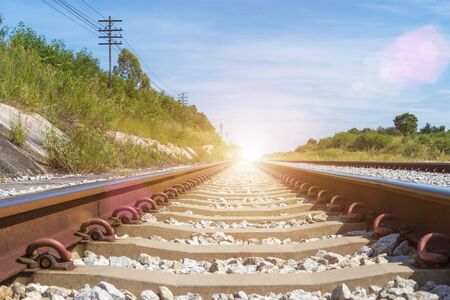 Travel and transportation background concept. Empty railway or railway tracks with blue sky at sunrise. Picture for add text message. Backdrop for design art work. Stok Fotoğraf - 132124625